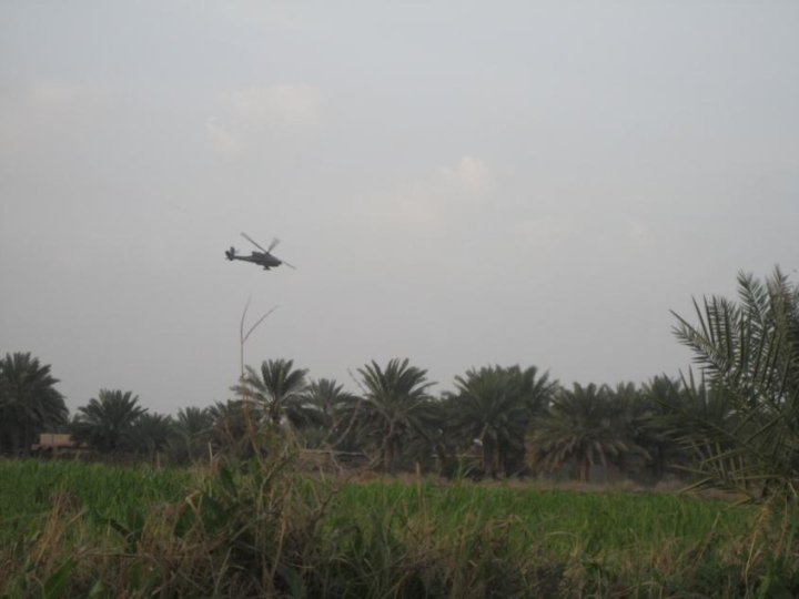 Motivator: An AH-64D Apache Gunship flies in low and hard during a raid in Babil Province, Iraq in support of my infantry platoon during a raid on a road side bomb making location.